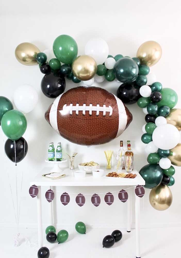 The relaxed balloon arch frames the main star of the Super Bowl party