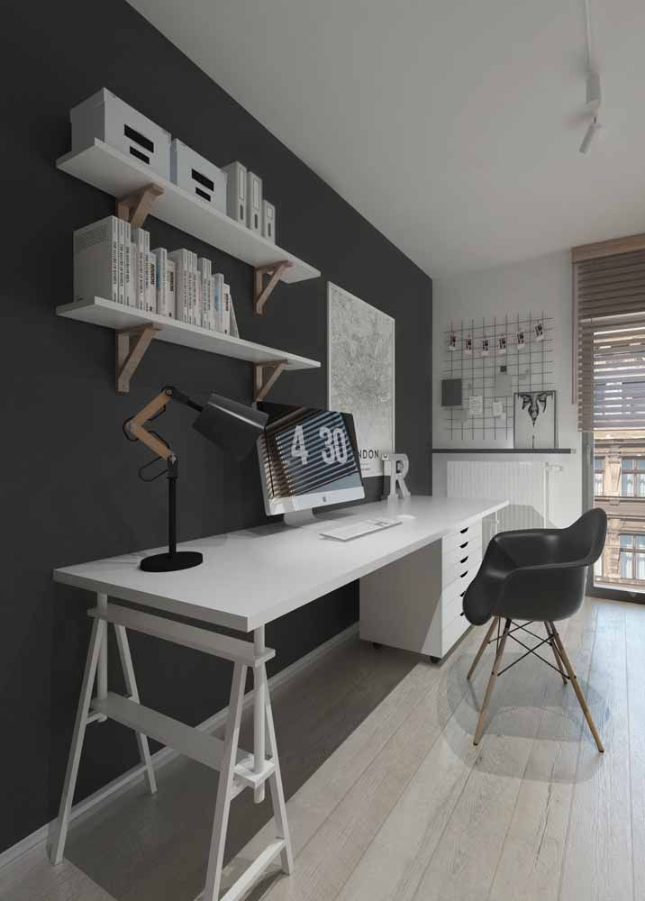 Modern black and white office with easel desk