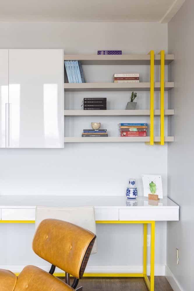 Here, the white industrial-style desk has yellow accents to contrast with the environment