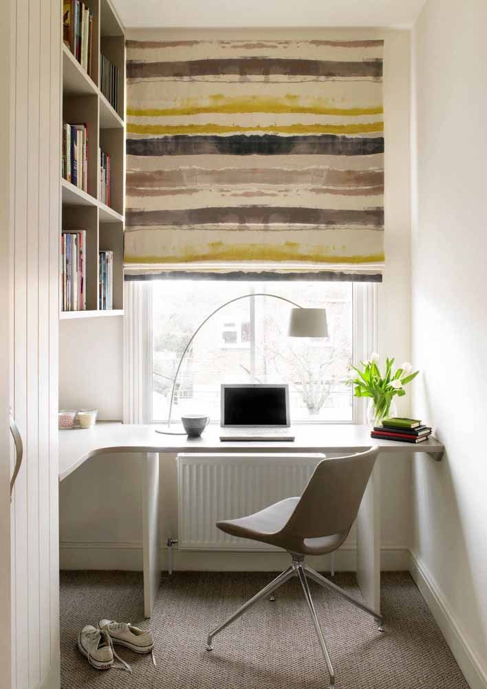 Next to the window, this white corner desk forms a charming partnership with the colored roller blind