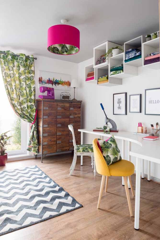 The white desk allows the colorful decor to stand out