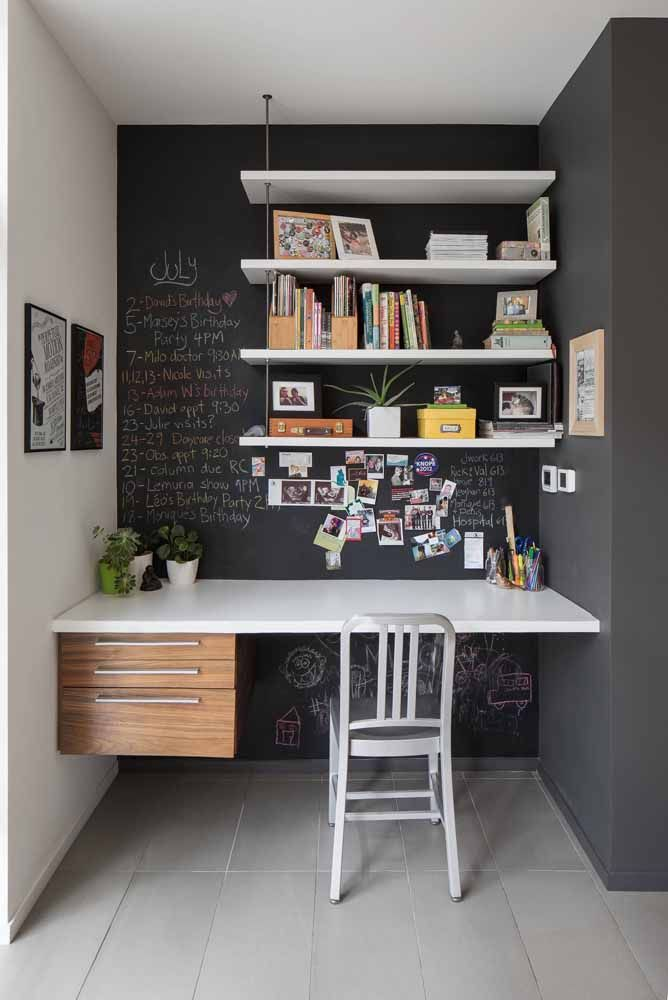 And to create that contrast that everyone loves, a slate wall highlighted by the white desk and shelves