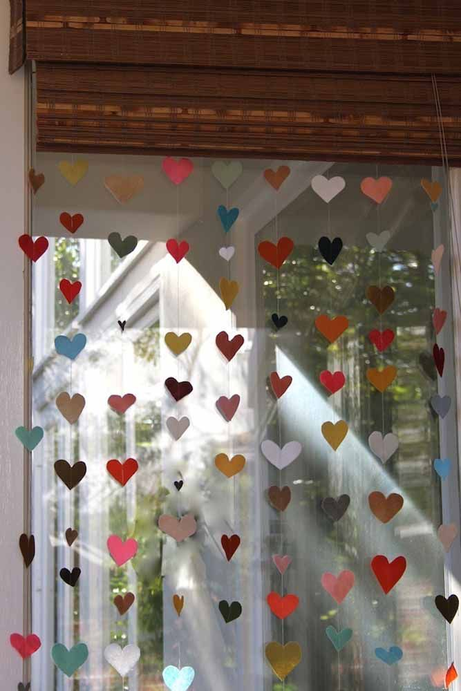 Here, the heart curtain was used for the decoration of the house; notice that the colored hearts are next to the wooden shutter