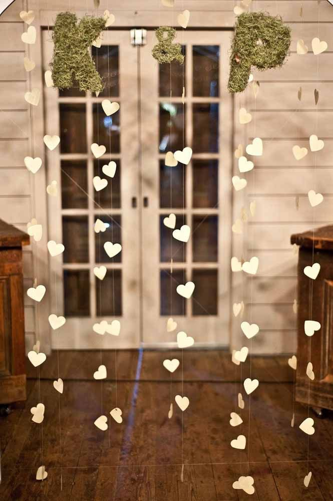 The curtain of white hearts brings the bride and groom's initials attached to it