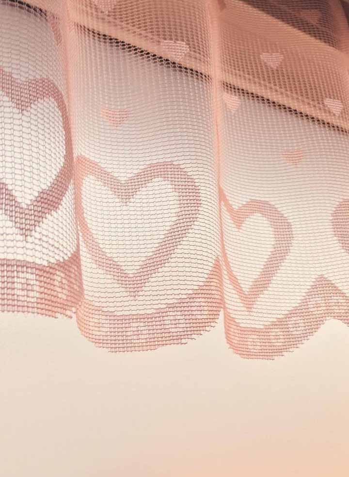 Here, the heart curtain is literally a curtain, all made of fabric