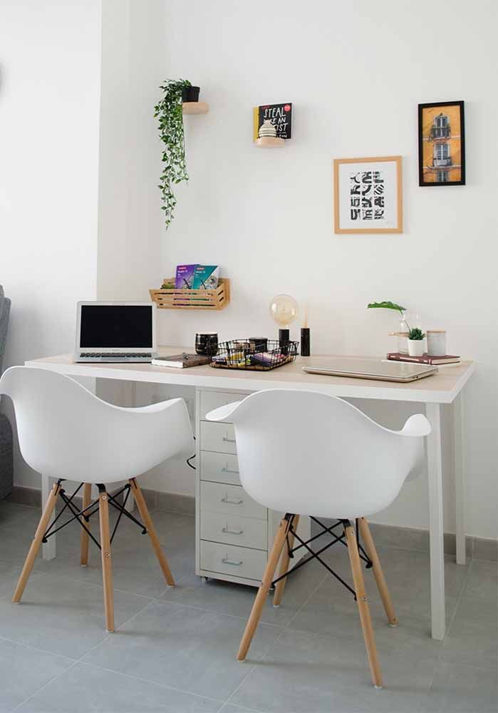 Simple white desk divided by drawer