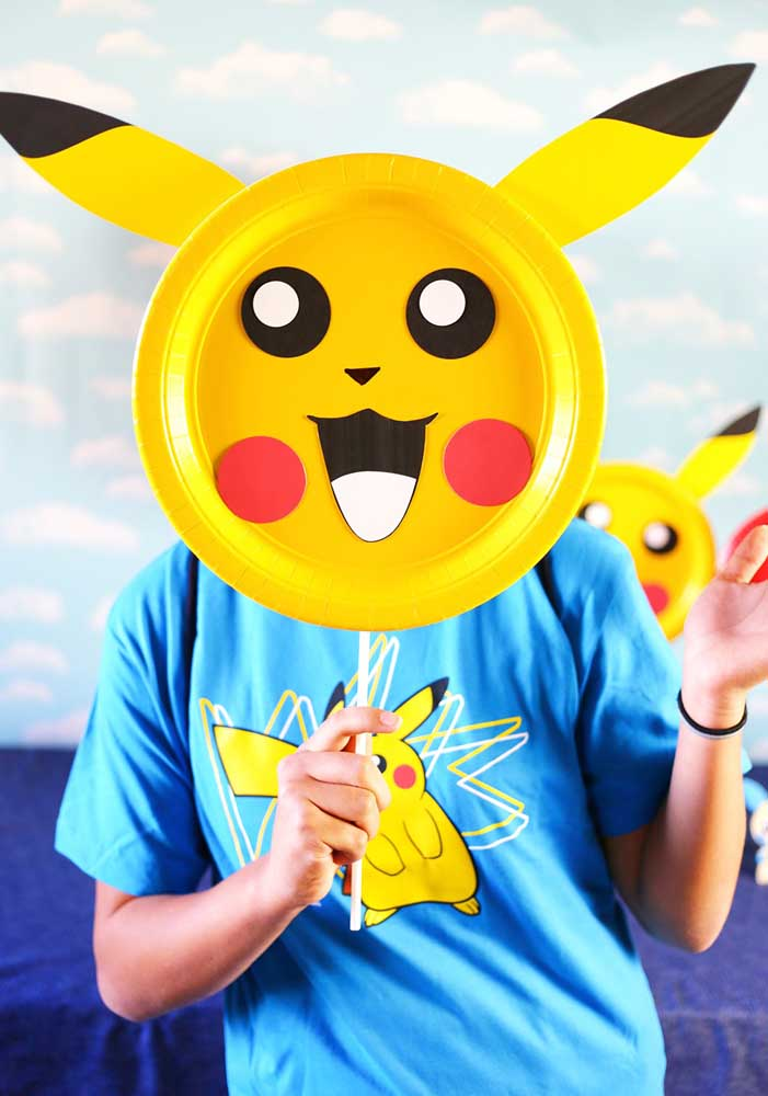 How about distributing pikachu mask for the guests to have fun at the party?