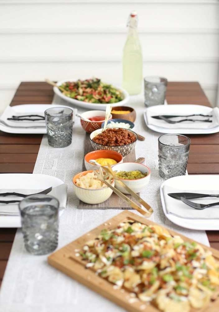 Prepare a table with accompaniments for hot dogs.