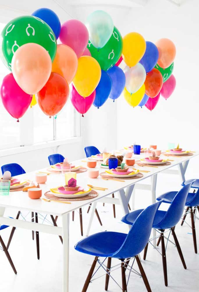 To decorate the main table, use colored balloons suspended on the table. More colorful, impossible!