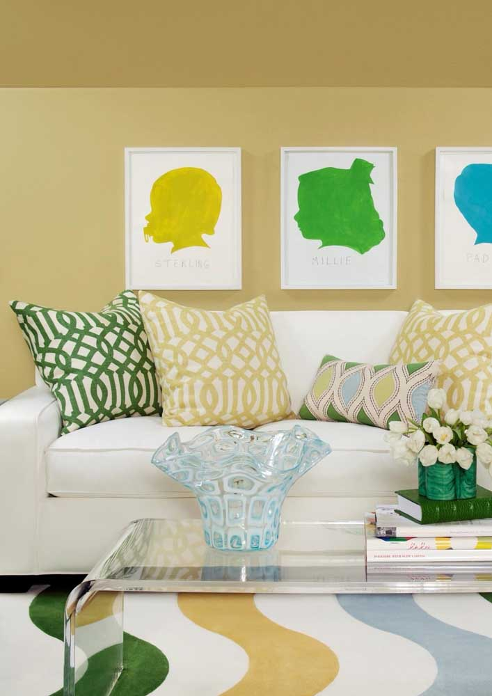 Modern living room decorated in a closed yellow tone combined with white, green and blue details