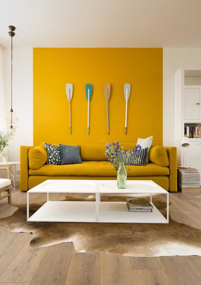 In this room, only the wall strip behind the sofa received yellow paint