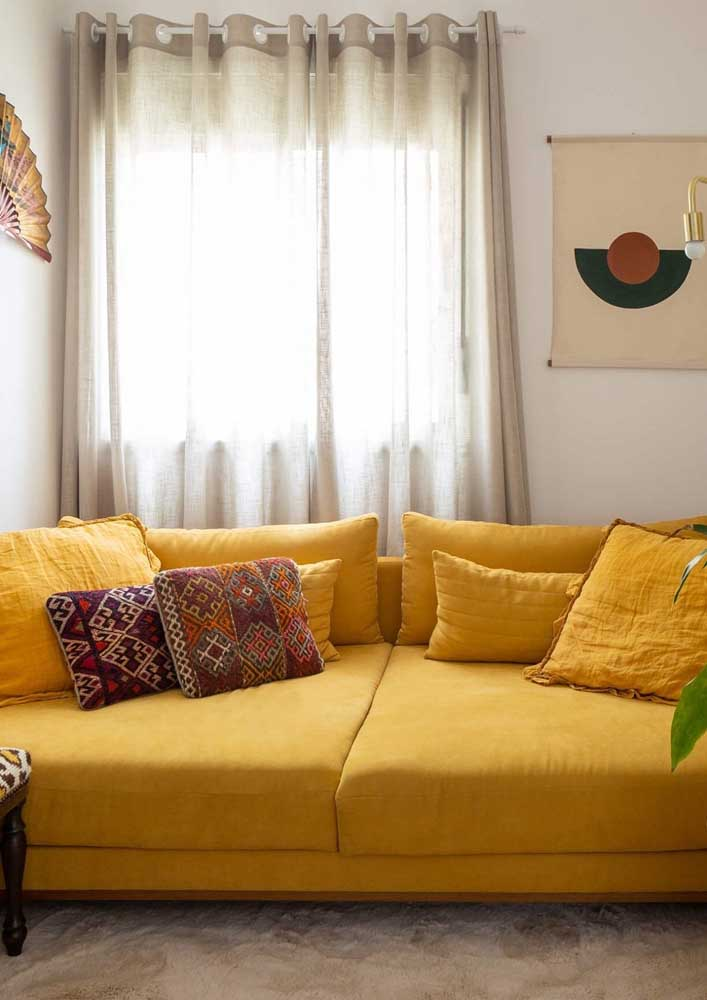 Feel embraced by this yellow sofa