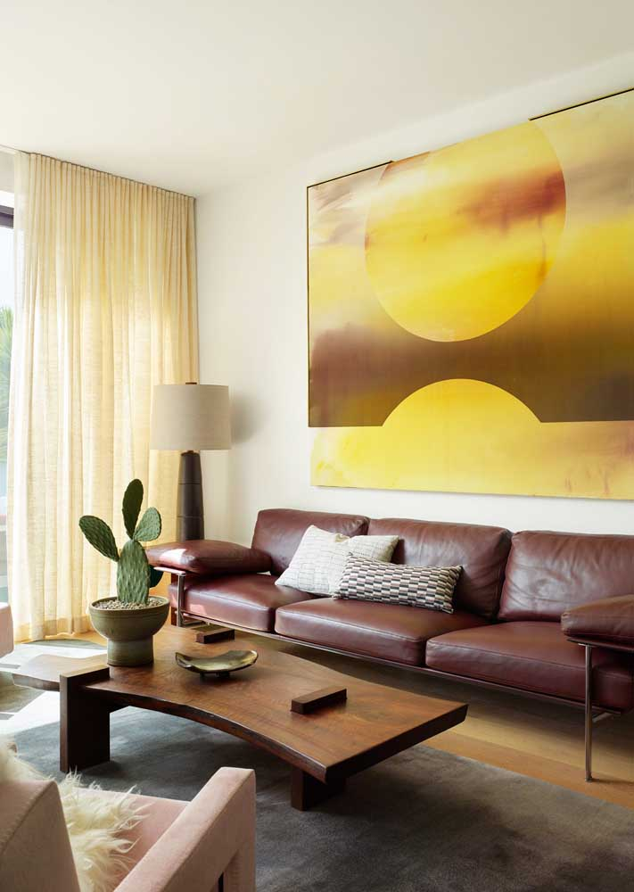 A classic living room marked by the use of yellow and brown