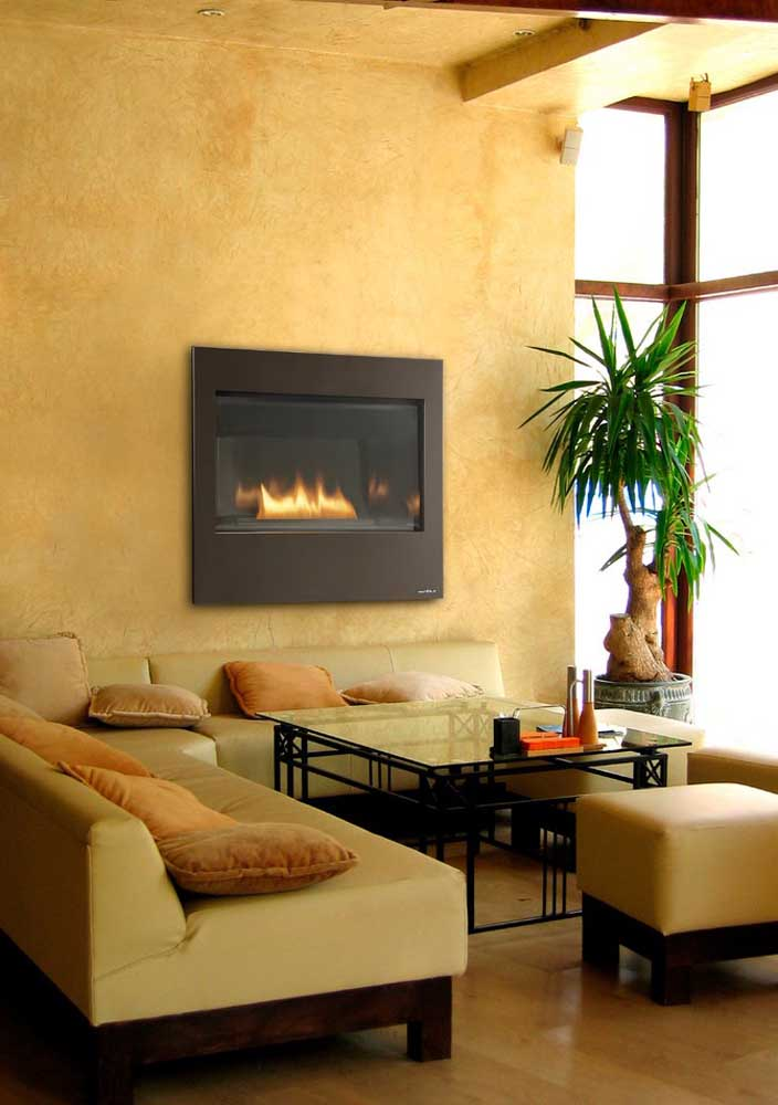 The textured wall with fireplace has a super cozy yellow tone