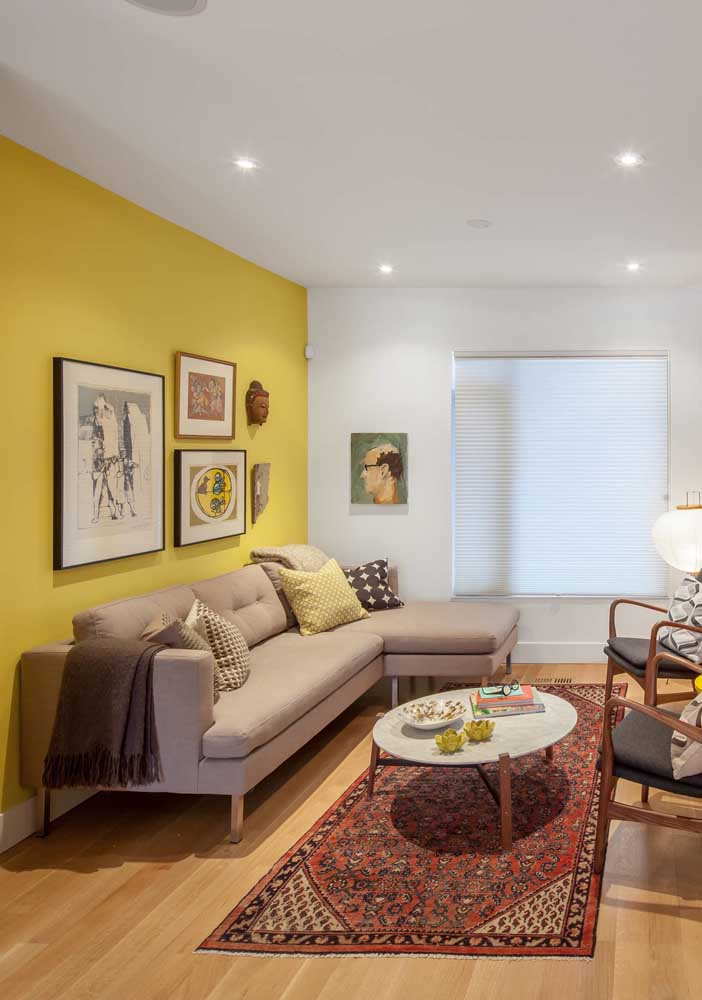 Notice what a simple yellow wall can do for a room. Indirect lighting helps to create a feeling of comfort