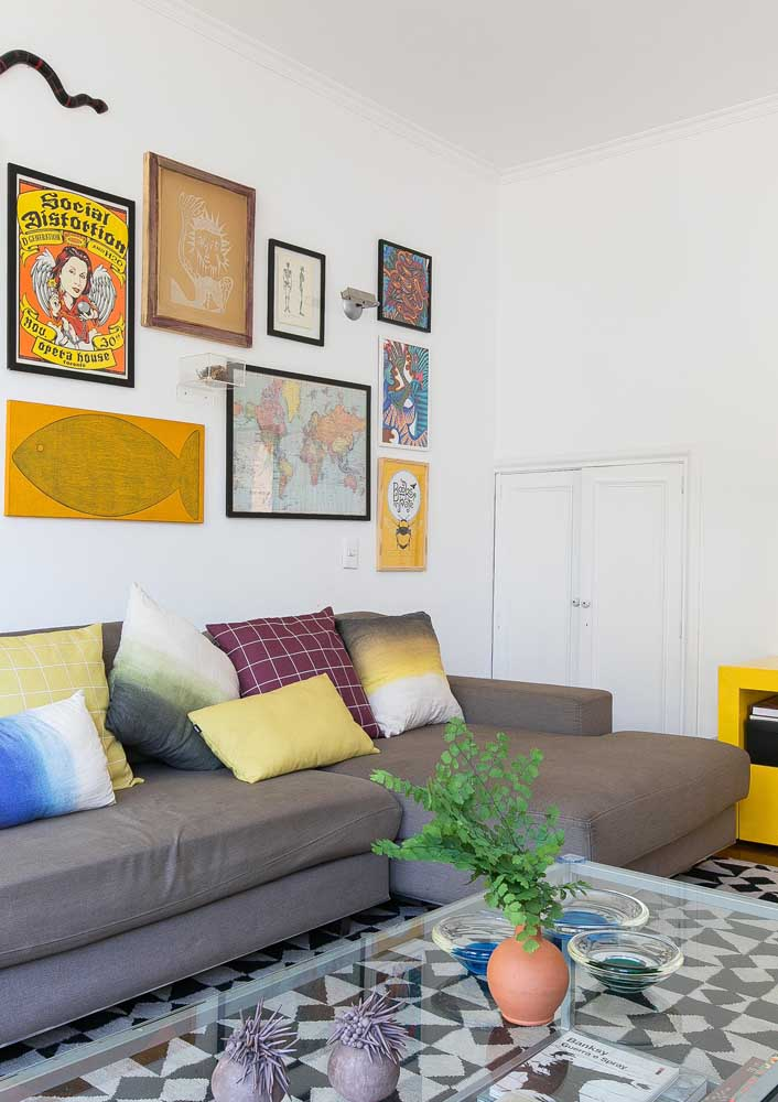 On one side, a simple living room decorated with yellow accents