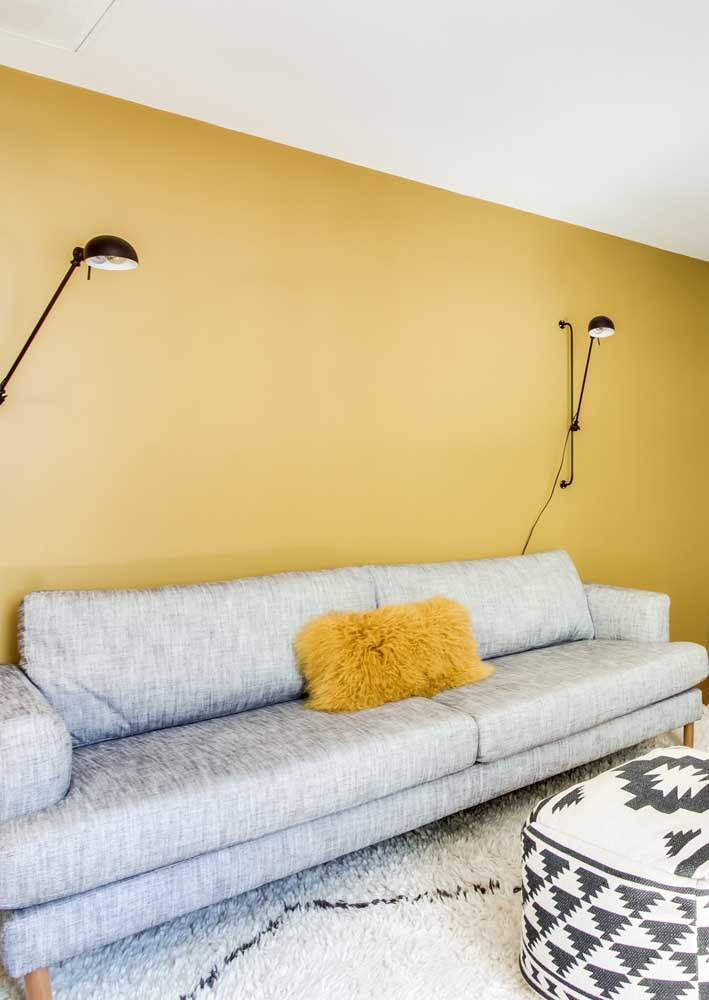 Here, the yellow wall matched the gray sofa like a glove