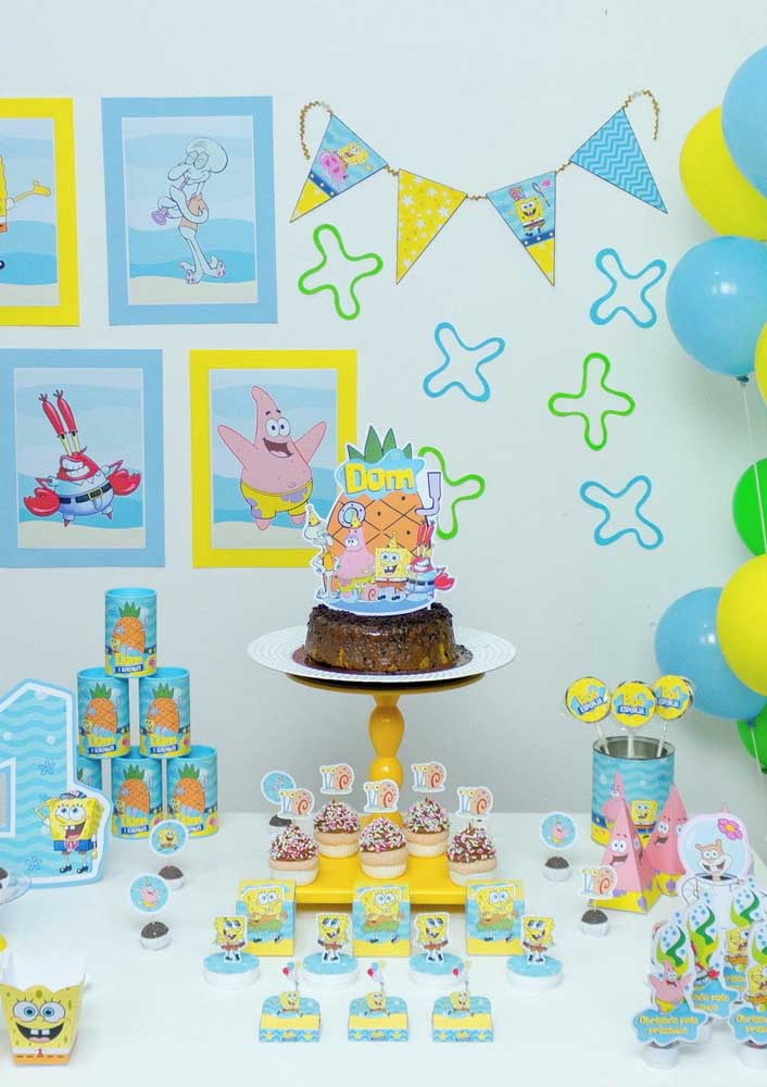 Use the souvenirs and sweets to help decorate the SpongeBob cake table