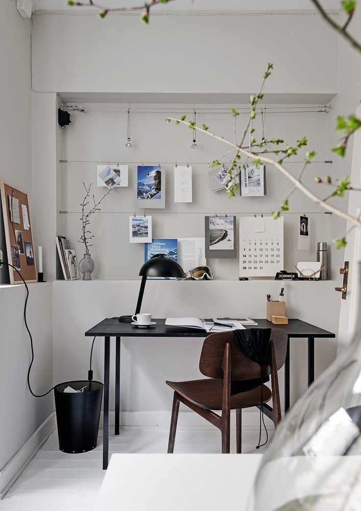 A simple table and chair solved this small home office. Highlight for the clothesline that allows you to hang important papers and notes