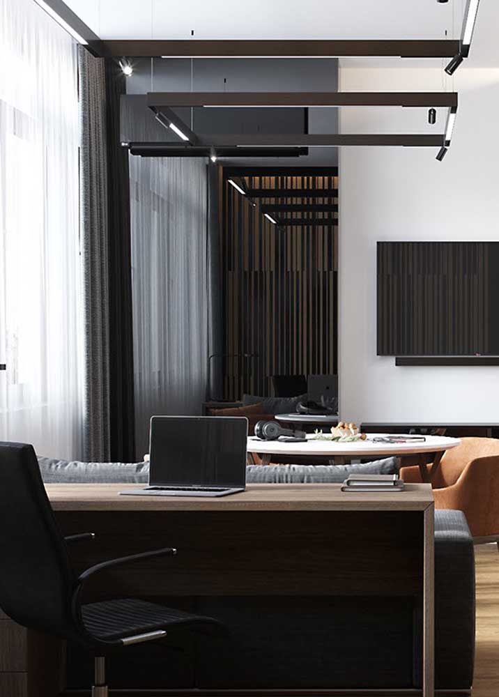 In this home office model, the work table was fitted behind the living room sofa