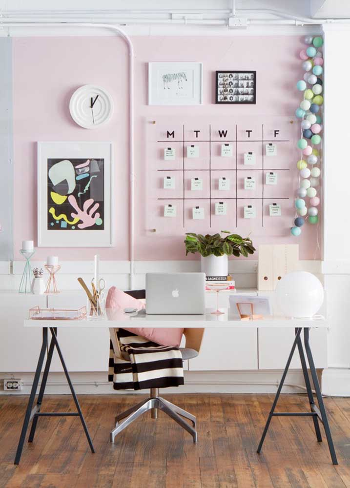 Modern home office with easel table and pink wall
