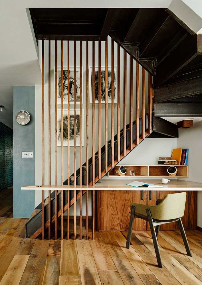 Take advantage of the empty space under the stairs and make your office