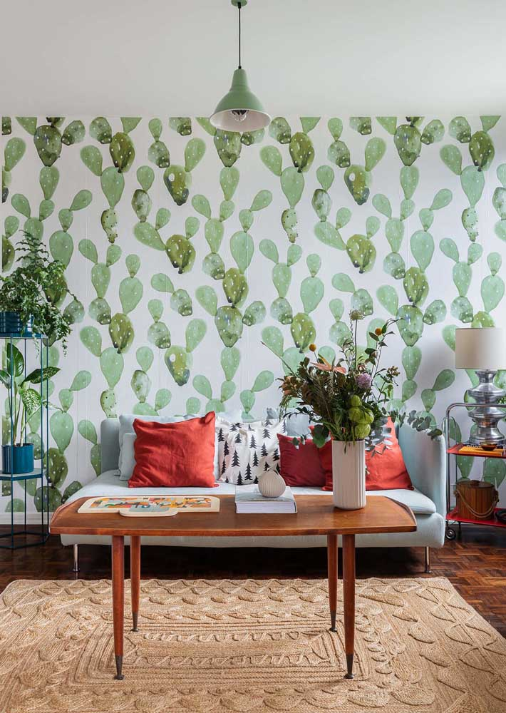 The green of this room is due to the wallpaper of leaves and plants
