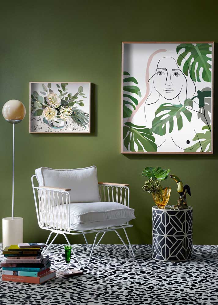 The green can be inserted in the room by the wall paint, the pictures and the presence of the plants