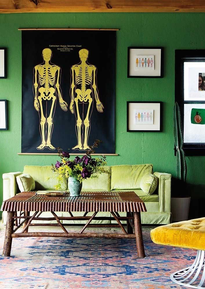Classic combination that always works: green wall with green sofa in tone on tone