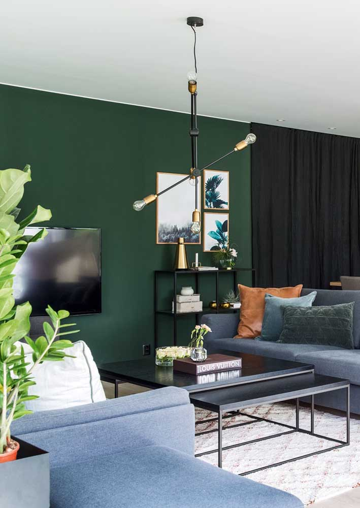 Green room with black accents. Subtle and elegant combination.