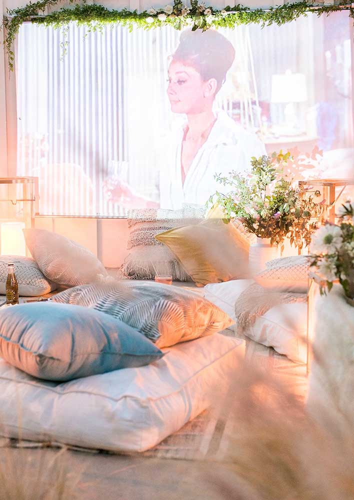 A big screen and cushions like this one and the guests will never leave!