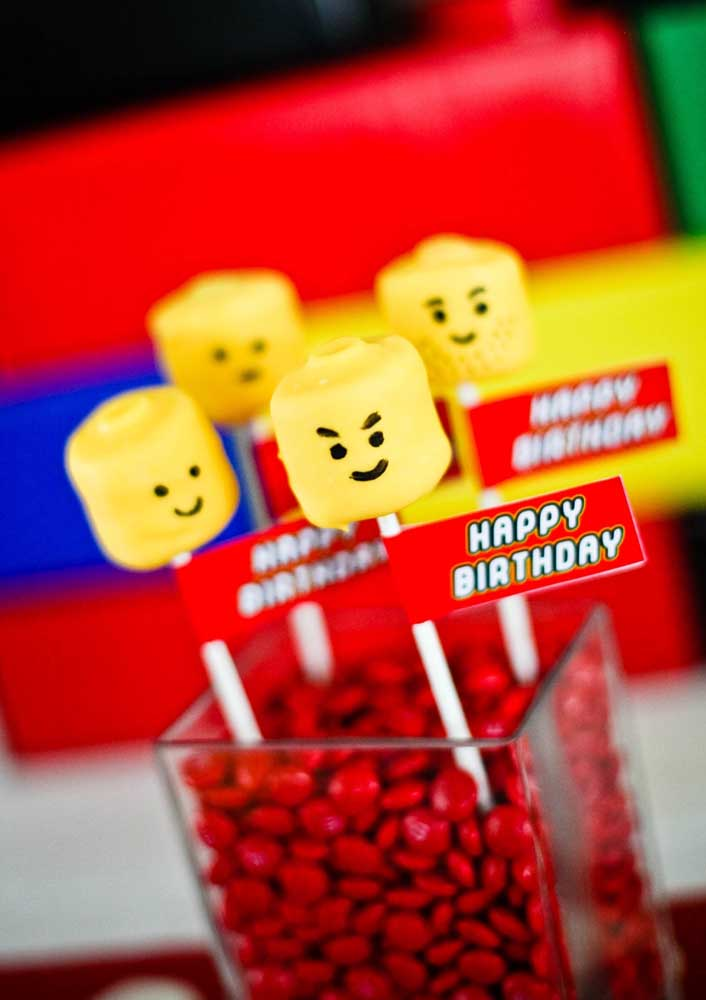 Lego Party centerpiece suggestion: glass jars with chocolate confetti decorated with minifigures totems