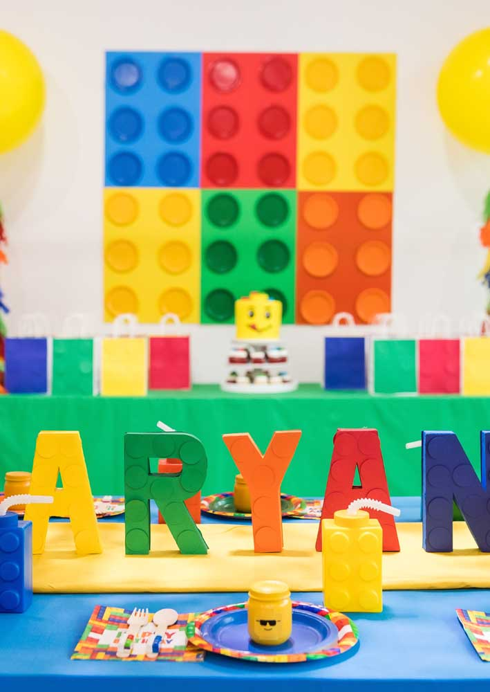 """Lego party decoration with emphasis on strong and cheerful colors. Notice the birthday boy's name written with personalized Lego """"pieces"""""""