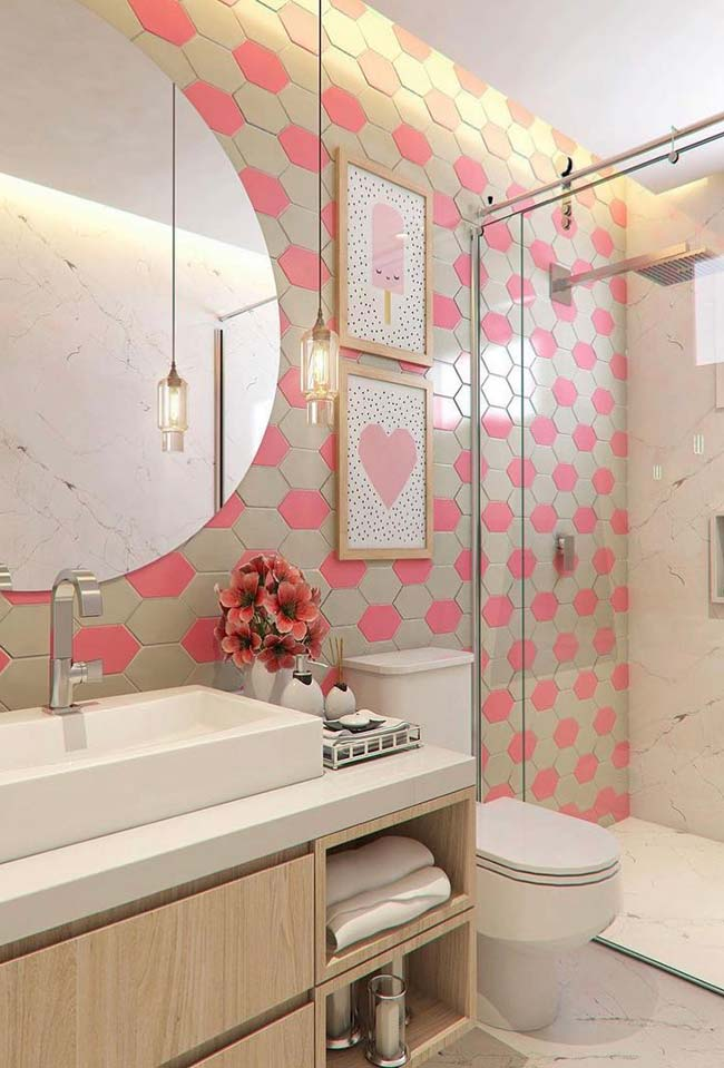 Pink and beige tile in small decorated bathrooms