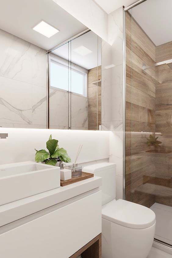 Wooden details enhance the white bathroom
