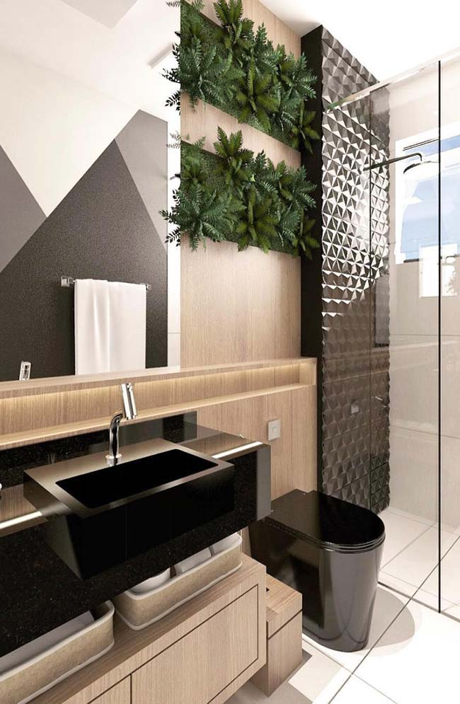 Black brings sophistication to the small decorated bathroom