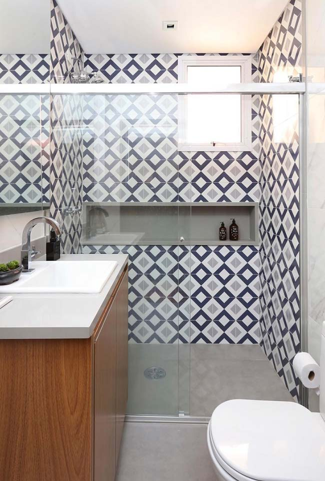 Gray tiles in the shower box harmonize with the rest of the bathroom gray