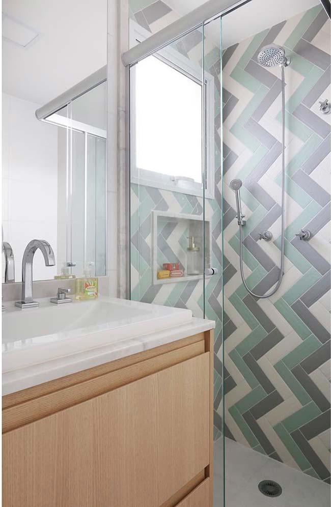 Cabinet of this small decorated bathroom ends on top of the shower door opening
