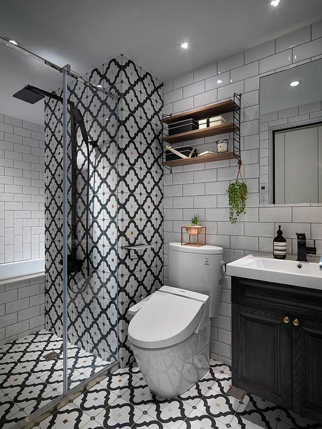 small bathroom decorated in black and white