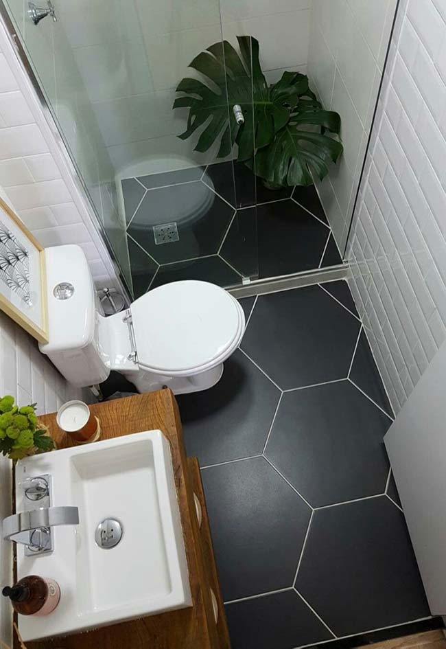 Small bathrooms decorated with white walls and black floors