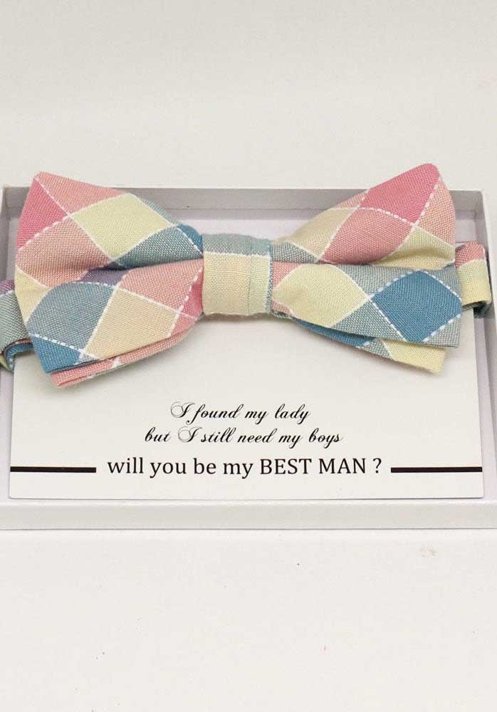 In this invitation, instead of the traditional tie, a bow tie was offered to the groomsmen