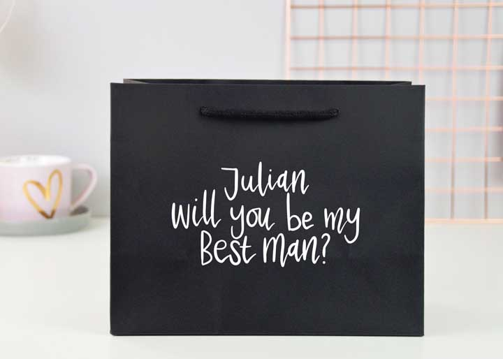 Instead of a box, use a bag as an invitation to the groomsmen