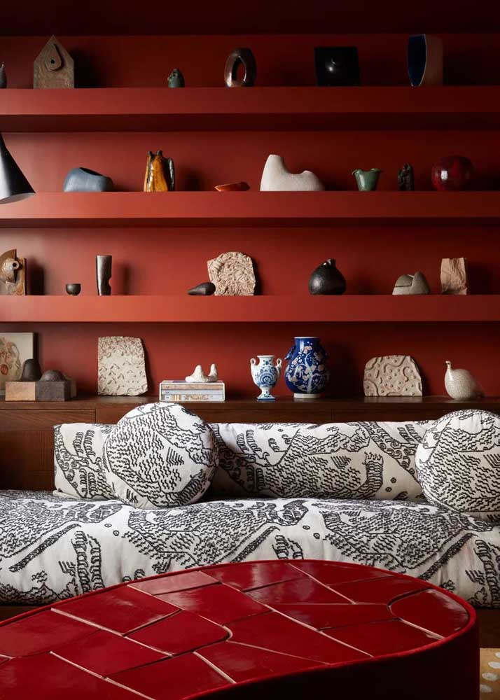 Room with bookcase and red coffee table. Notice that the tones, although different, harmonize