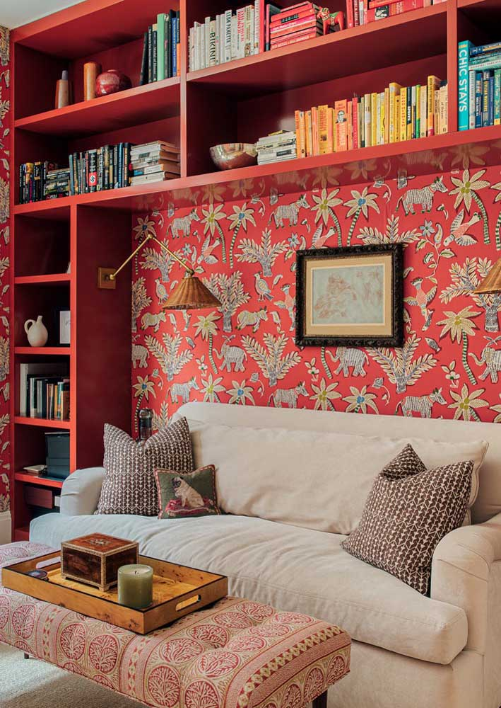 Here, red is accompanied by a delicate floral print. Red MDF niches complete the project