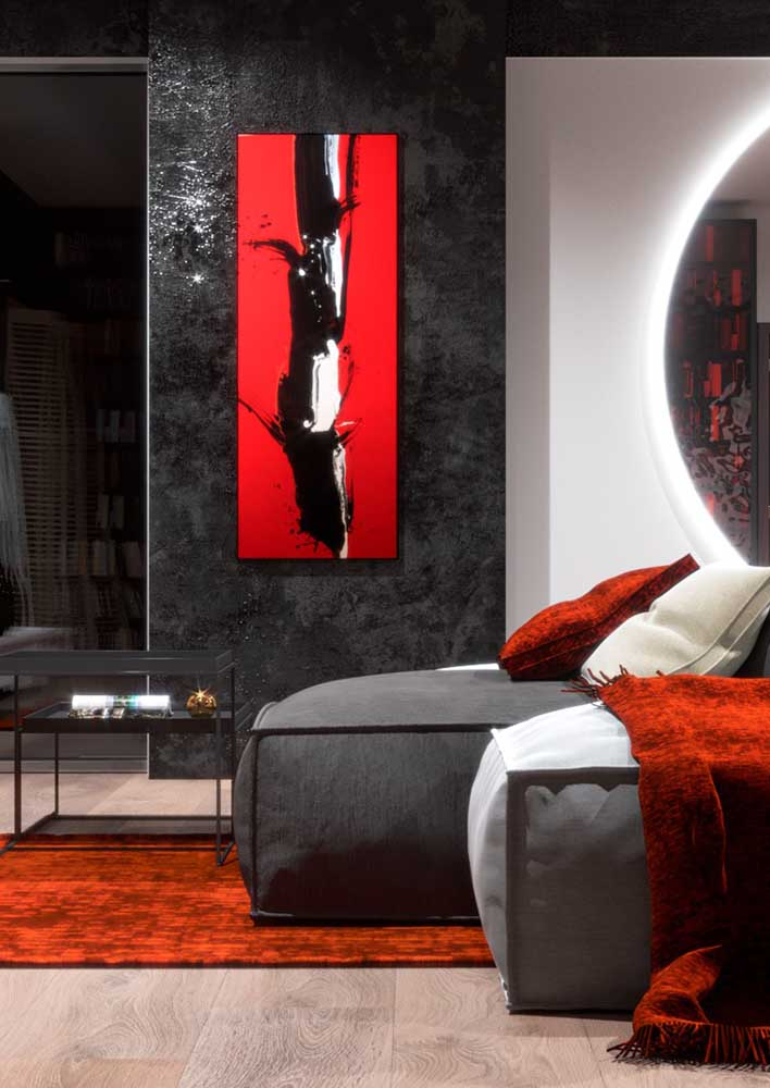 Gray room with red accents to bring that warmth to the environment