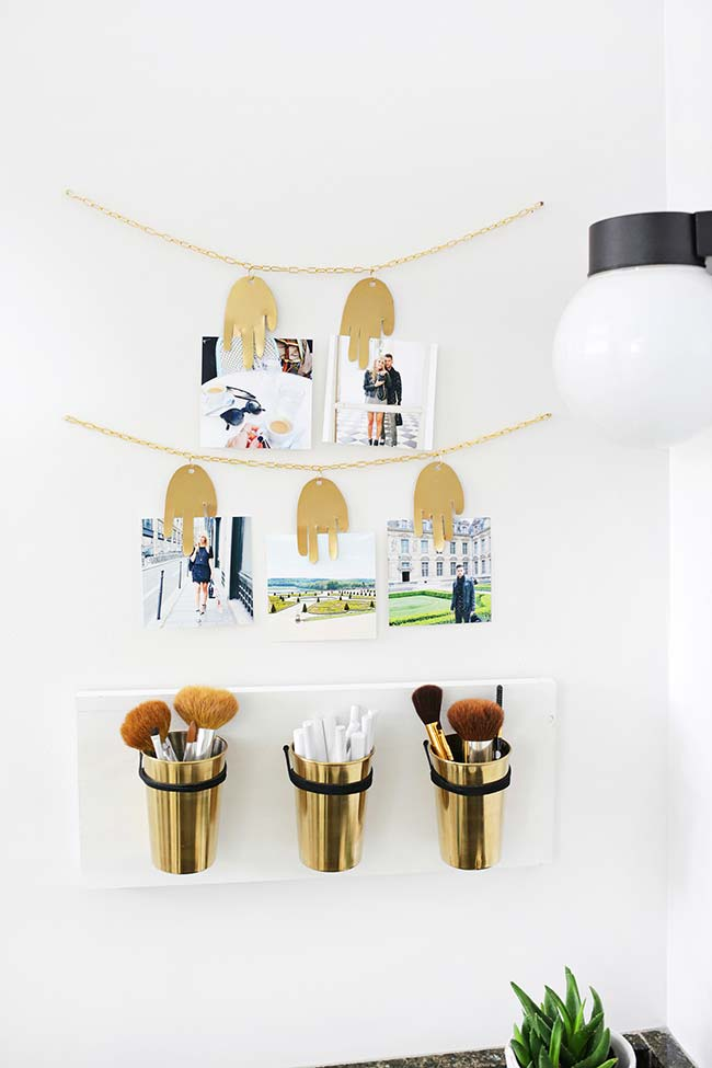 Clothesline of photos with golden chains