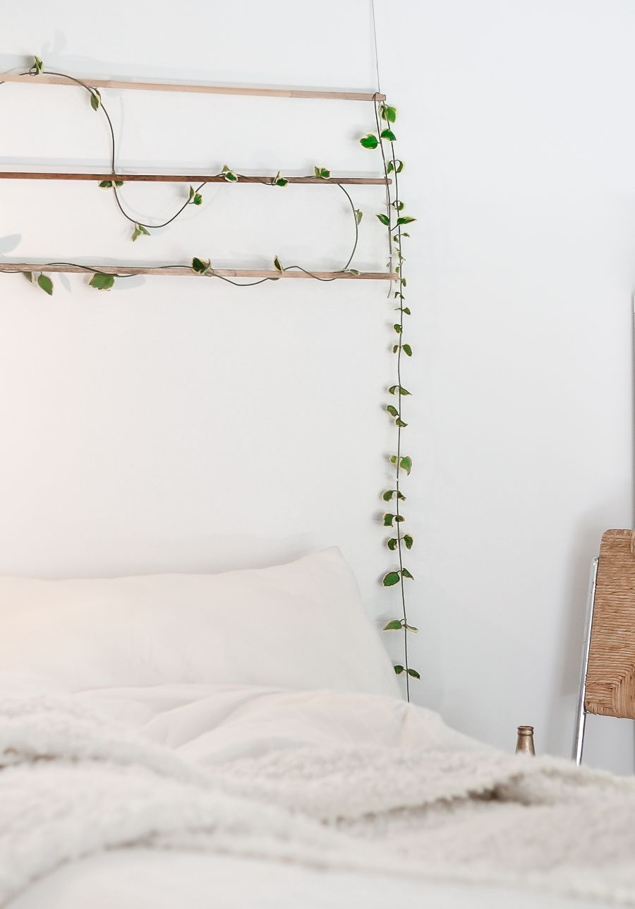 Clothesline of green leaves forms a graceful detail on the bed