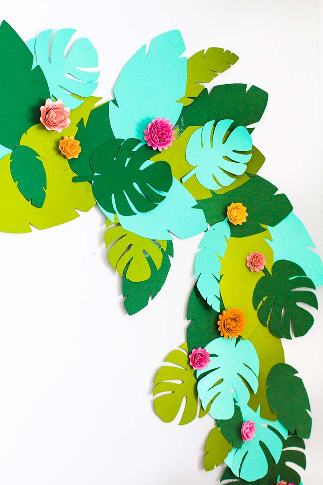 Tropical and colorful decoration for the wall made with flowers and EVA leaves