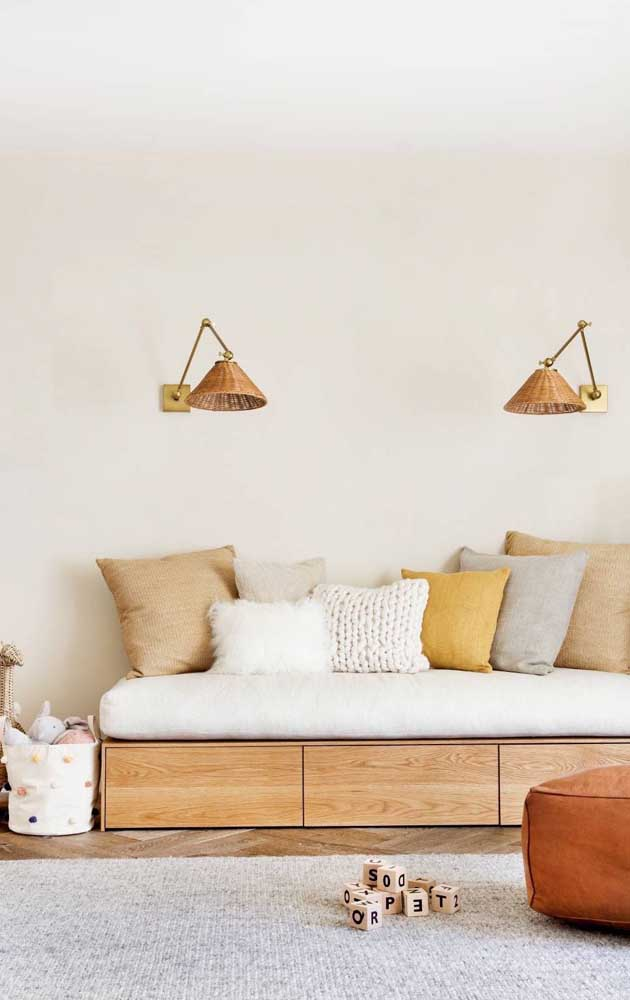 Ivory, gray and mustard make up the color palette of this living room