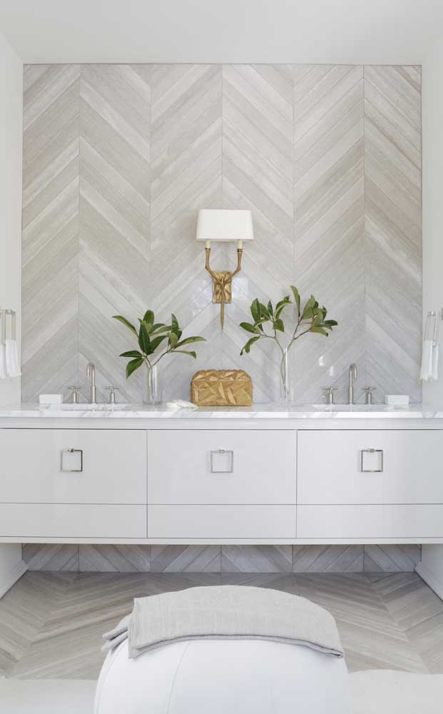 Gray and ivory wall tiles decorate this bathroom